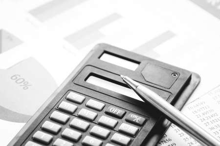 calculator and pen on book finance and account