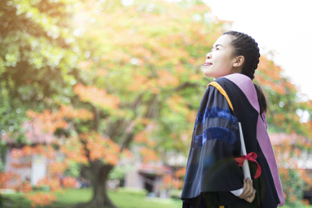 Happy and glad graduated Asian student girl standing, congratulations, graduate education success, concept education and finished learning in class