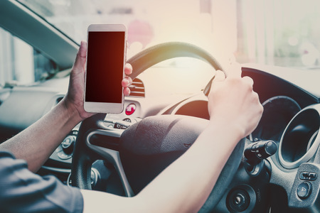 vdo: Man use phone and looking on empty screen of mobilephone, concept as looking way of street because of traffic jam, working in car, vdo call and wiresless Stock Photo
