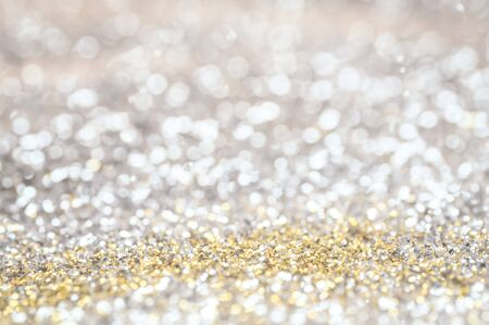 defocus of glitter vintage lights background. gold, silver and black for Christmas and new year background.