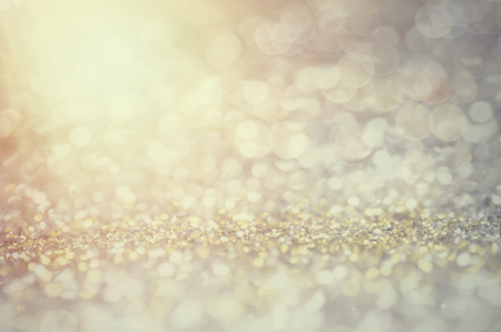 defocus of glitter vintage lights background. gold, silver, blue and black for Christmas and new year background.