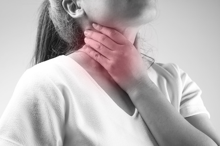 back ache: women has neck pain, illness concept in black and white