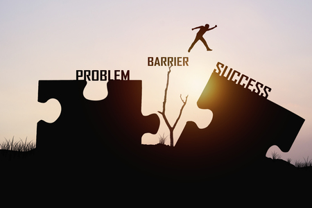 difficult lives: man jumping over jigsaw opposite success shore, concept as can solve  problem, barrier , belive and faith to conncet business Stock Photo