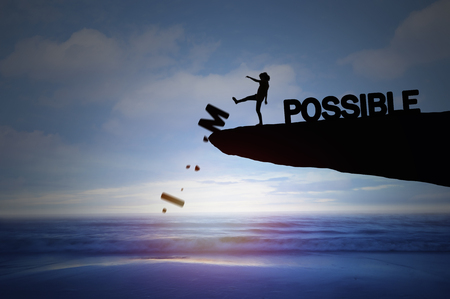 Silhouette of people kick impossible to be possible, concept as success in business and leadership