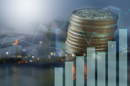 Double exposure of stacked of coins with graph and night city, concept as finance and capital banking