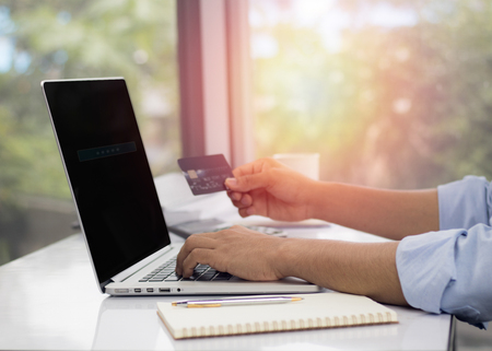 connection connections: Man using laptop for shopping online in office and home