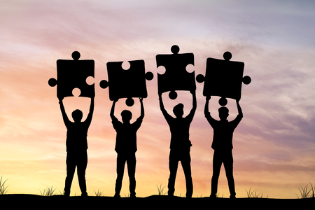 connection connections: Silhouette of Businessmen holding jigsaw in sunset , concept as team work and cooperate to success in business