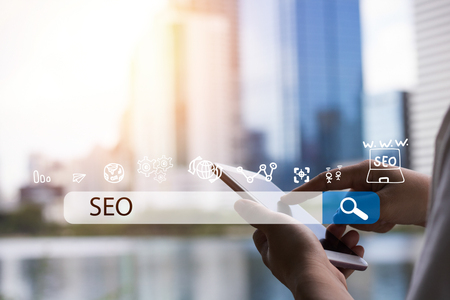 Searching Engine Optimizing SEO Browsing Concept, Businessman holding phone for looking information with technology and internet icon