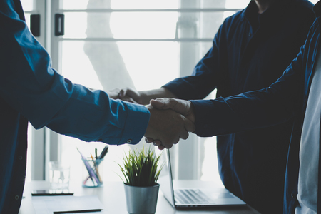 cooperation and success concept, team of business people shaking hand with boss or leader outside for greeting and deal successful business project Фото со стока