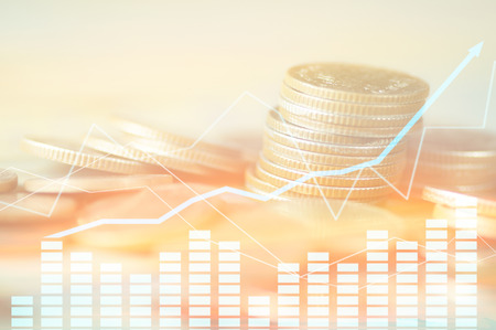 Finance, profit, capital banking and investment concept, Double exporsure stacked of coins and night city with graph