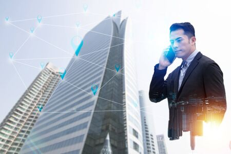 Double exposure of Businessman calling phone and building in city  for connection and communication with wifi, internet with partner of business and connection line concept