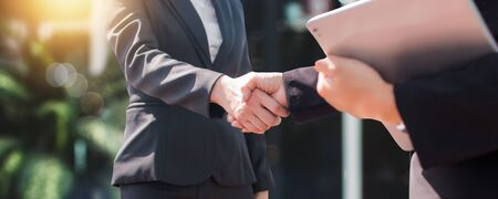successful negotiate and handshake concept, two businessman shake hand with partner to celebration partnership and teamwork, business deal Фото со стока