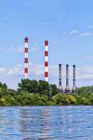 Chimneys of the heating plants over the river - Belgrade, Serbia photo