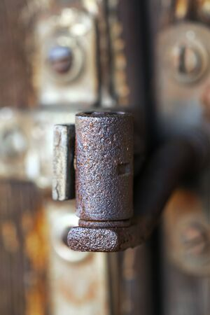 Rusty hinge on old window photo