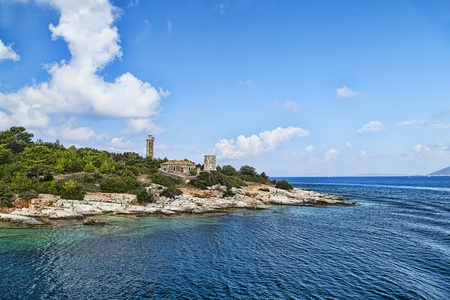 kefallonia: Old lighthouse with fortress, Fiskardo, Kefallonia, Greece;  Stock Photo