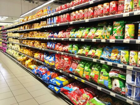 Shelf with foods in supermarket