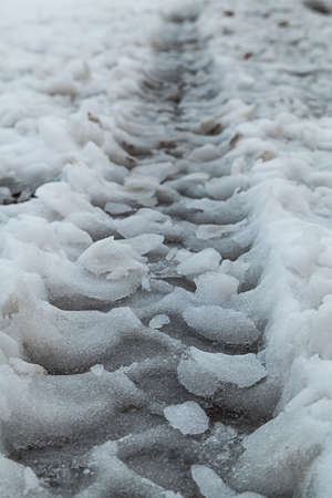 tire track on wet snow photo
