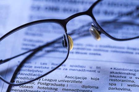 studding: Glasses on newspaper