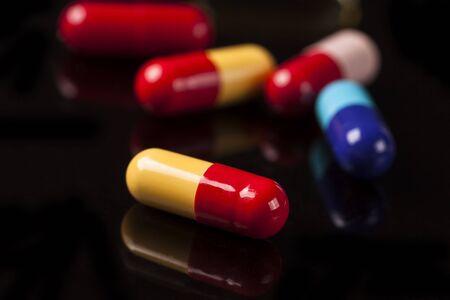 penicillin: Medical pills on the black glass