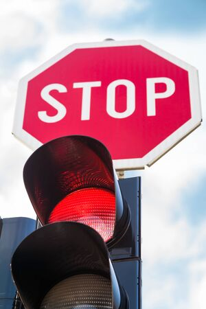 standstill: Traffic lights with the red light lit and stop sign Stock Photo