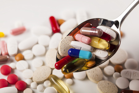 penicillin: Colorful capsules with spoon Stock Photo