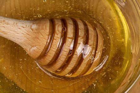 dipper: Wooden honey dipper Stock Photo