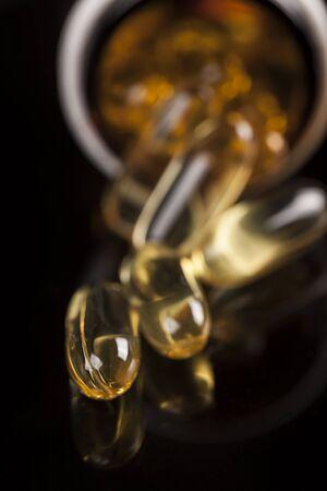 ingest: Pills spilling out of prescription bottle Stock Photo