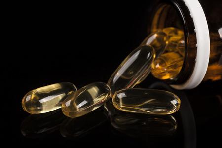 vitamin d: Pills spilling out of prescription bottle Stock Photo