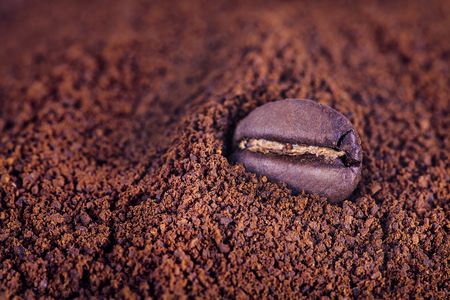 Close up of coffee raw bean at roasted coffee heap Stock Photo