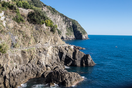 Cinque Terre Riomaggiore Coast on blue sea photo