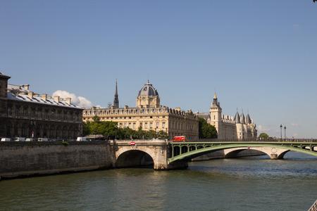 cite: Palais de Justice standing on the banks of river Seine on the island Il de la Cite, Paris - France