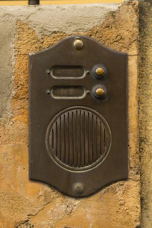 intercom: An old, rusty intercom in Italy.