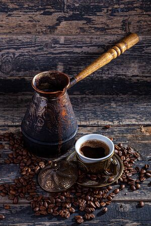 Hot cofee on wood background