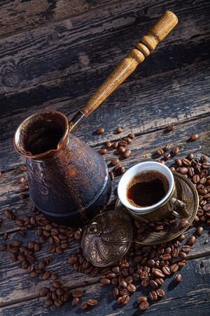 Hot cofee on wood background