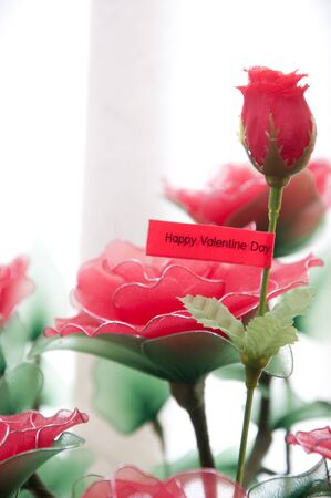 a picture of happy valentine day tag with roses in basket photo