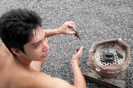 asian man light coal stove Stock Photo - 11229779