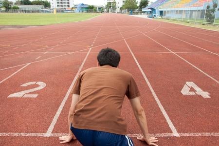 asian man runner on running track photo