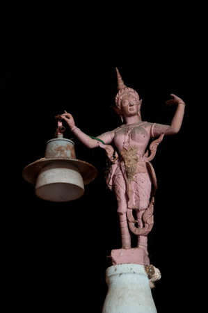 ancient light lamp statue in yala cave temple, thailand photo