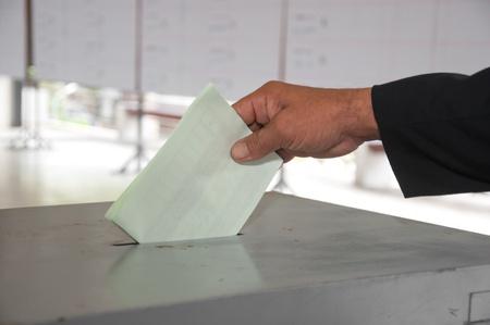 hand put voting paper Stock Photo - 11365126