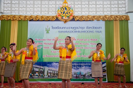 YALA, THAILAND - SEPTEMBER 16: unidentified Students of Kanarasadornbumroong School perform thai dance to Malaysian Teacher for visit school at Kanarasadornbumroong School on SEPTEMBER 16, 2011 in YALA, THAILAND