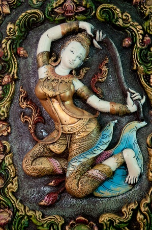 woman statue thai art in thai temple Stock Photo