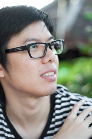 asian thai chinese smiled smart man with glasses photo