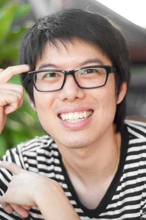 asian thai chinese smiled smart man with glasses thinking consulting photo