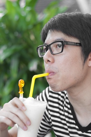 smiled: asian thai chinese smiled smart man with glasses drinking