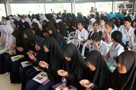 to attend: YALA, THAILAND - DECEMBER 3: Unidentified students attend for religious seminar in Religious Seminar for Thai Kings Birthday on Dec 3, 2011 at Youth Center Yala, Thailand