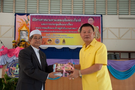 birthday religious: YALA, THAILAND - DECEMBER 3: Mr.Suchart Suwannakas Yala Province Deputy give gift for seminar helper in Religious Seminar for Thai Kings Birthday on Dec 3, 2011 at Youth Center Yala, Thailand