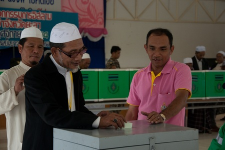 committee: YALA, THAILAND - NOVEMBER 24:Unidentified Islamic religious chief votes for yala Islamic committee election in Yala Islamic committee election on Nov 24, 2011 at Yala Youth Center, Thailand Editorial