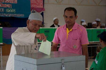 committee: YALA, THAILAND - NOVEMBER 24:Unidentified Islamic religious chief votes for yala Islamic committee election in Yala Islamic committee election on Nov 24, 2011 at Yala Youth Center, Thailand Editorial
