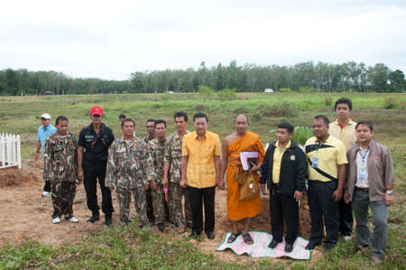 adulyadej: YALA, THAILAND - DECEMBER 2:Mr.Wittaya Panichphong Deputy Governor stands in tree planting for H.M.K. Bhumibol Adulyadej Birthday ceremony on Dec 2, 2011 at Yala Yoo-po Distric, Thailand