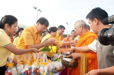 YALA, THAILAND - DECEMBER 5: Unidentified Yala people put food offerings for monks in blessing ceremony for the H.M.K. Bhumibol Adulyadej Birthday ceremony on Dec 5, 2011 at Yala Youth Center, Thailand Stock Photo - 11653421